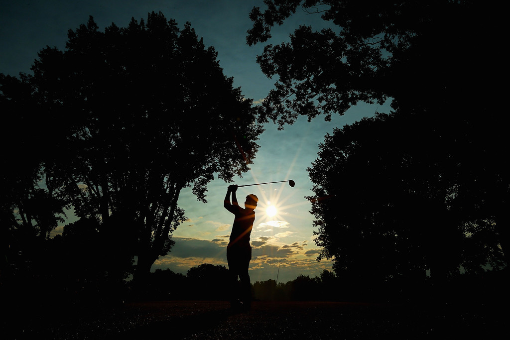 . ROCHESTER, NY - AUGUST 08: Hiroyuki Fujita of Japan hits his tee shot on the tenth hole during the first round of the 95th PGA Championship on August 8, 2013 in Rochester, New York.  (Photo by Streeter Lecka/Getty Images)