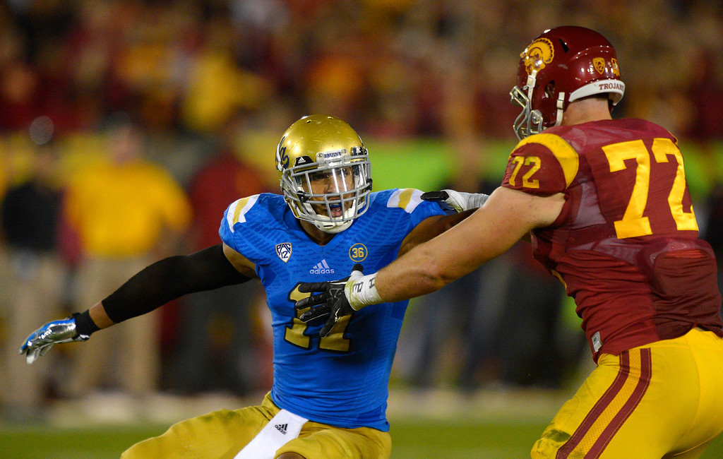 . In this Nov. 30, 2013, file photo, UCLA linebacker Anthony Barr, left, tries to get by Southern California offensive tackle Chad Wheeler during the first half of an NCAA college football game in Los Angeles. Barr was selected by the Minnesota Vikings as the #9 pick. AP Photo/Mark J. Terrill, File)