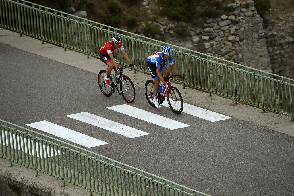 . Switzerland\'s champion Martin Elmiger (L) and New Zealand\'s Jack Bauer ride in a breakaway during the 222 km fifteenth stage of the 101st edition of the Tour de France cycling race on July 20, 2014 between Tallard and Nimes, southern France.  LIONEL BONAVENTURE/AFP/Getty Images