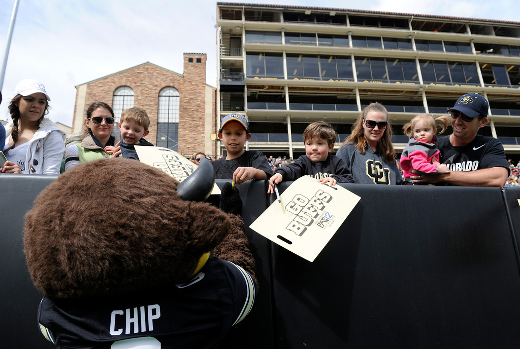 """. BOULDER, CO.- APRIL13: \""""Chip\"""" signs a few autographs for the fans. The University of Colorado football team hosts its spring football game at Folsom Field under the direction of new head coach Mike Macintyre. (Photo By Kathryn Scott Osler/The Denver Post)"""