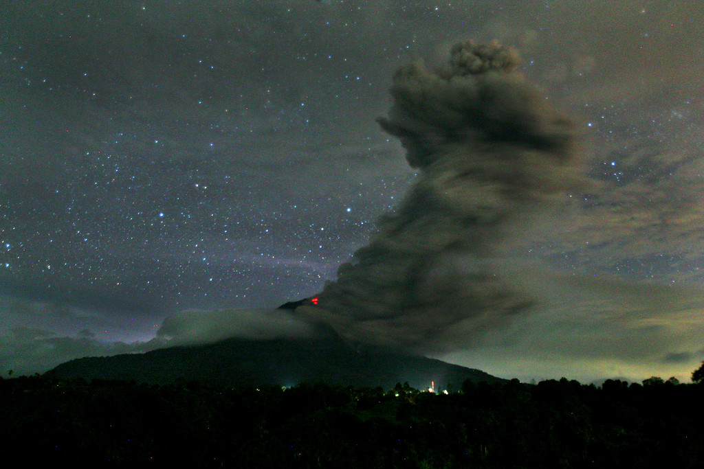 . In this late Sunday, Nov. 24, 2013 photo, Mount Sinabung spews volcanic ash into the air as seen from Tiga Pancur, North Sumatra, Indonesia.  (AP Photo/Binsar Bakkara)