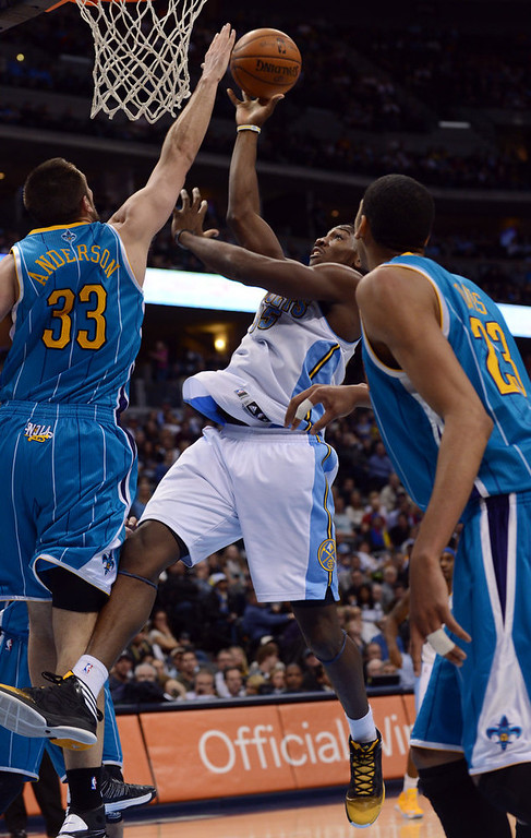 . DENVER, CO. - FEBRUARY 01: Kenneth Faried of Denver Nuggets #35 drives for the basket against Ryan Anderson of New Orleans Hornets #33 in the 2nd half of the game on February 1, 2013 at the Pepsi Center in Denver, Colorado. Denver won 113-98. (Photo By Hyoung Chang/The Denver Post)