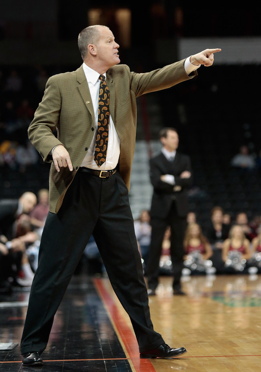 . Head coach Tad Boyle of the Colorado Buffaloes directs his players during the second half of the game against the Washington State Cougars at Spokane Arena on January 8, 2014 in Spokane, Washington.  (Photo by William Mancebo/Getty Images)