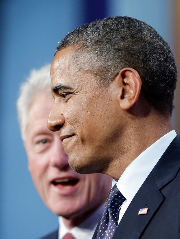 . President Barack Obama, right, on stage with former President Bill Clinton, left, after speaking at the Clinton Global Initiative in New York, Tuesday, Sept. 24, 2013. (AP Photo/Pablo Martinez Monsivais)