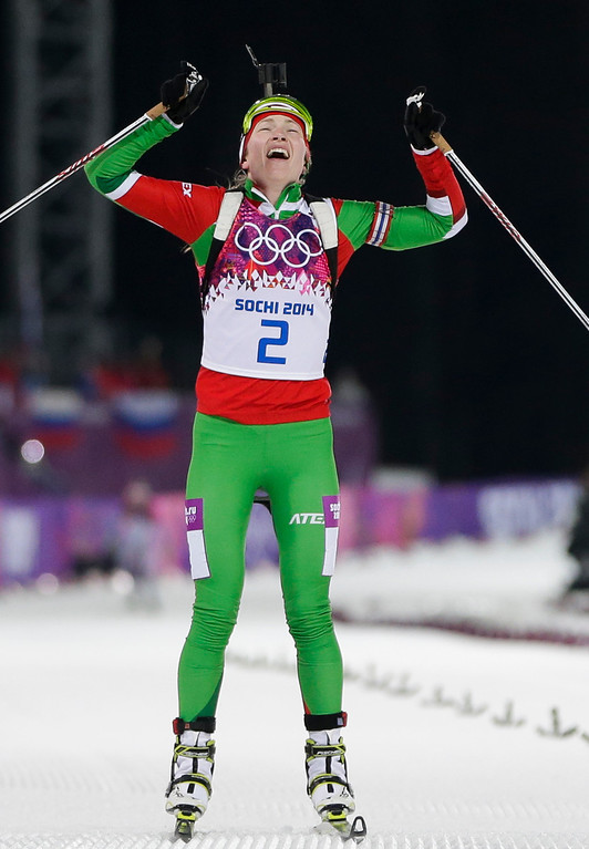 . Belarus\' Darya Domracheva celebrates winning the gold medal in the women\'s biathlon 12.5k mass-start, at the 2014 Winter Olympics, Monday, Feb. 17, 2014, in Krasnaya Polyana, Russia. (AP Photo/Felipe Dana)