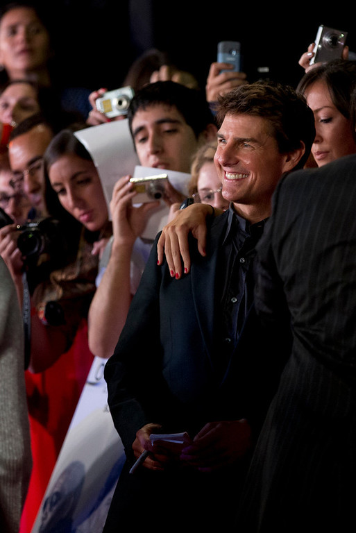 ". U.S. actor Tom Cruise, right, posses for a picture with fans during a presentation to promote his film ""Oblivion\"" in Buenos Aires, Argentina,  Tuesday, March 26, 2013. (AP Photo/Natacha Pisarenko)"