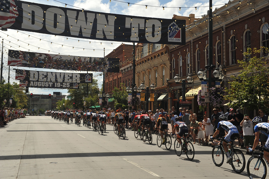 . Cyclists pass by Larimer Square during the 75-mile 7th stage of the 2013 USA Pro Challenge race in Denver on August 25, 2013. (Photo by Hyoung Chang/The Denver Post)