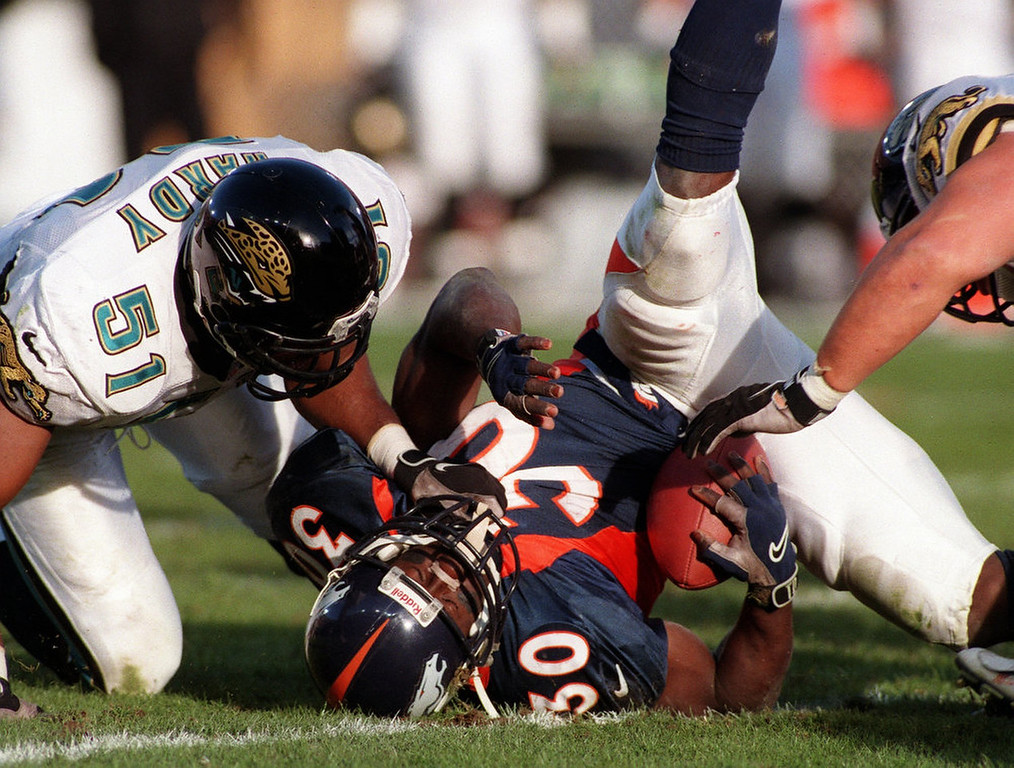 . Jaguars #51d Kevin Hardy puts a hit on Terrell Davis in  the 2nd quarter of the Wild Card Playoff game at Mile High  Stadium. Photo by John Leyba, The Denver Post
