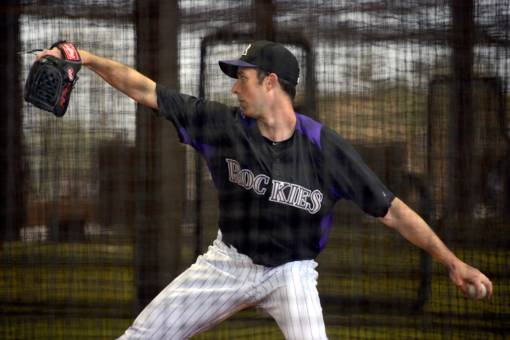 . SCOTTSDALE, AZ. - FEBRUARY 20: Jeff Francis of the Colorado Rockies pitches during workout in in the cages due to rain at Spring Training February 20, 2013 in Scottsdale. (Photo By John Leyba/The Denver Post)