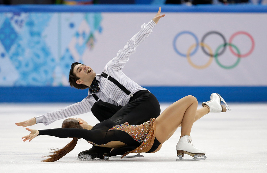 . Alisa Agafonova and Alper Ucar of Turkey compete in the ice dance short dance figure skating competition at the Iceberg Skating Palace during the 2014 Winter Olympics, Sunday, Feb. 16, 2014, in Sochi, Russia. (AP Photo/Darron Cummings)