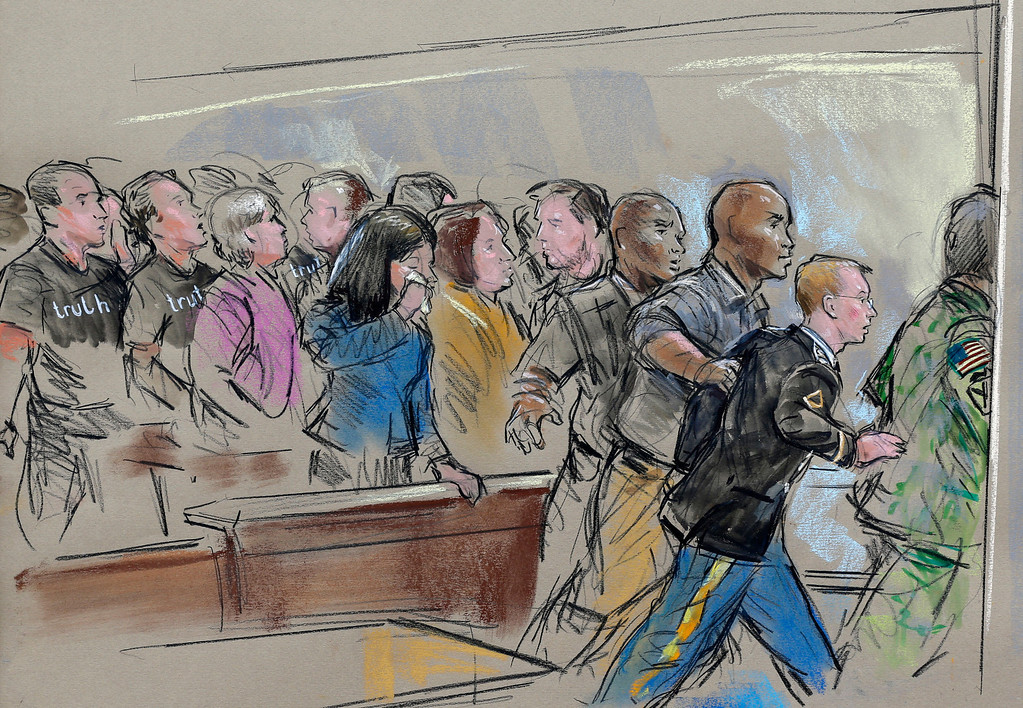 . In this courtroom sketch, Army Pfc. Bradley Manning, second from right, is escorted out of a courtroom after receiving a sentence of 35 years in prison for leaking classified materials to WikiLeaks in a hearing in Fort Meade, Md., Wednesday, Aug. 21, 2013. (AP Photo/William Hennessy)