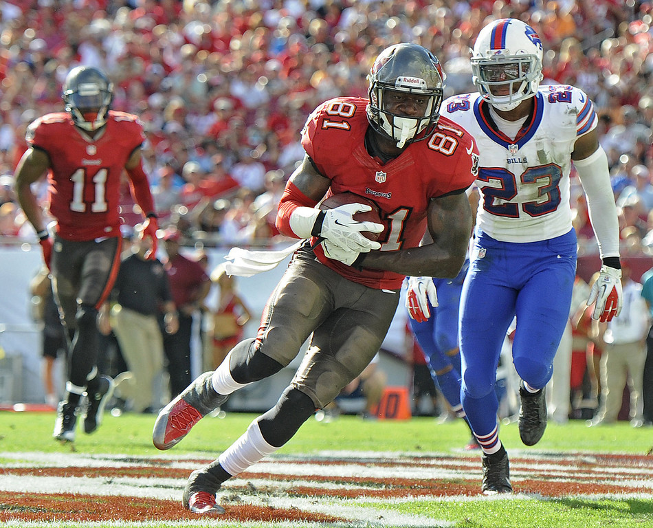 . Tampa Bay Buccaneers tight end Timothy Wright (81) scores past Buffalo Bills free safety Aaron Williams (23) on a five-yard touchdown reception during the second quarter of an NFL football game Sunday, Dec. 8, 2013, in Tampa, Fla. (AP Photo/Brian Blanco)