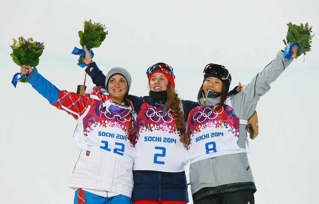 . Maddie Bowman of the United States, center, celebrates after winning the gold medal in the women\'s ski halfpipe final, with silver medalist Marie Martinod of France, left, and bronze medalist Japan\'s Ayana Onozuka, at the Rosa Khutor Extreme Park, at the 2014 Winter Olympics, Thursday, Feb. 20, 2014, in Krasnaya Polyana, Russia.(AP Photo/Sergei Grits)