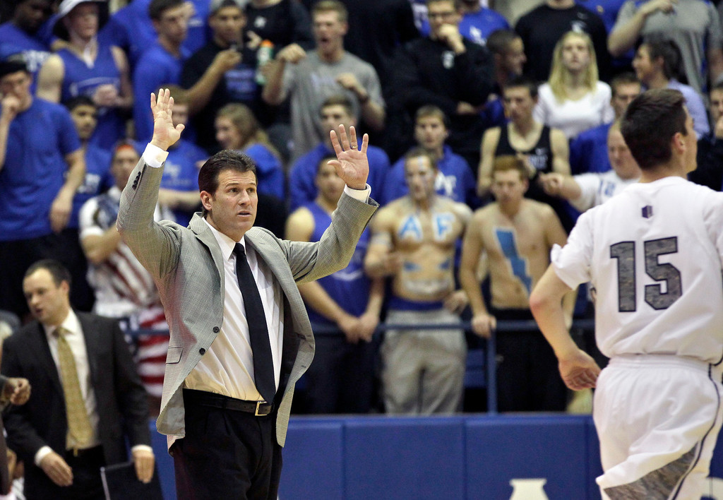 . New Mexico head coach Steve Alford reacts during the second half of an NCAA college basketball game against Air Force in Air Force Academy, Colo., Saturday, March 9, 2013. Air Force defeated New Mexico 89-88. (AP Photo/Brennan Linsley)