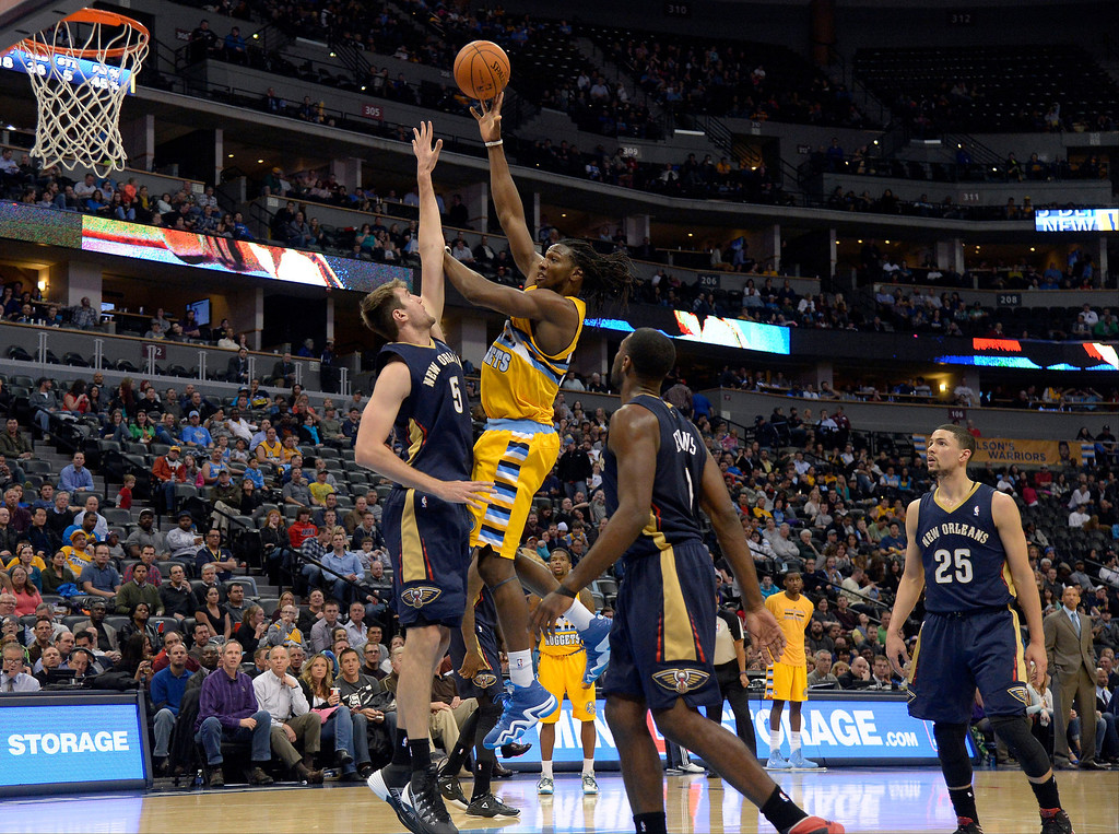 . Denver Nuggets forward Kenneth Faried (35) hits a jump hook over New Orleans Pelicans center Jeff Withey (5) during the fourth quarter to get his 34th point of the night April 2, 2014 at the Pepsi Center in Denver. This was a career high for Kenneth Faried. The Denver Nuggets defeated the New Orleans Pelicans 137-107. (Photo by John Leyba/The Denver Post)