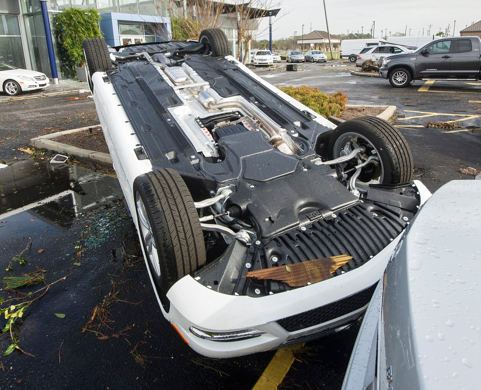 . An automobile sits upside down in the car lot of Mercedes-Benz of Mobile following a winter storm in Mobile, Alabama, December 20, 2012. The first major winter storm of the year took aim at the U.S. Midwest on Thursday, triggering high wind and blizzard warnings across a widespread area, and a threat of tornadoes in Gulf Coast states to the south. REUTERS/Jon Hauge