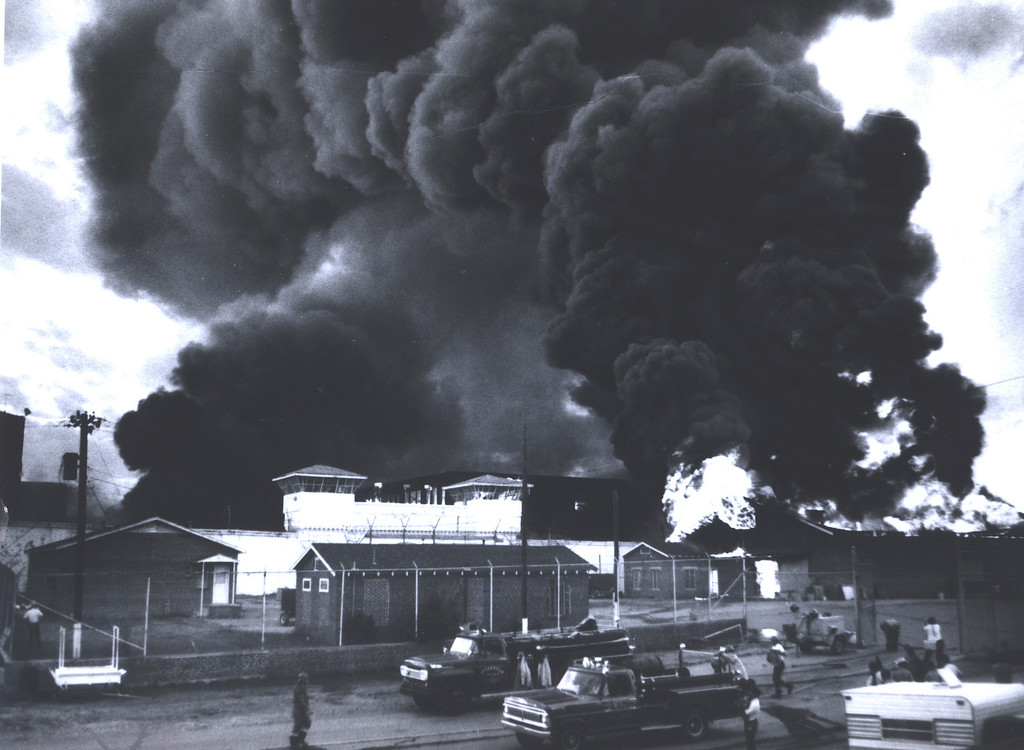 . In this July 1973 photo provided by the Oklahoma Department of Corrections, a fire burns inside the gate at the Oklahoma State Penitentiary at McAlester in McAlester, Okla., during one of the most destructive prison riots in American history. The prison erupted into violence on July 27, 1973, the result of overcrowding, inadequate supervision, poor health care and a culture of violence within the prison walls. The prison was eventually rebuilt as a maximum security prison. (AP Photo/Oklahoma Department of Corrections)