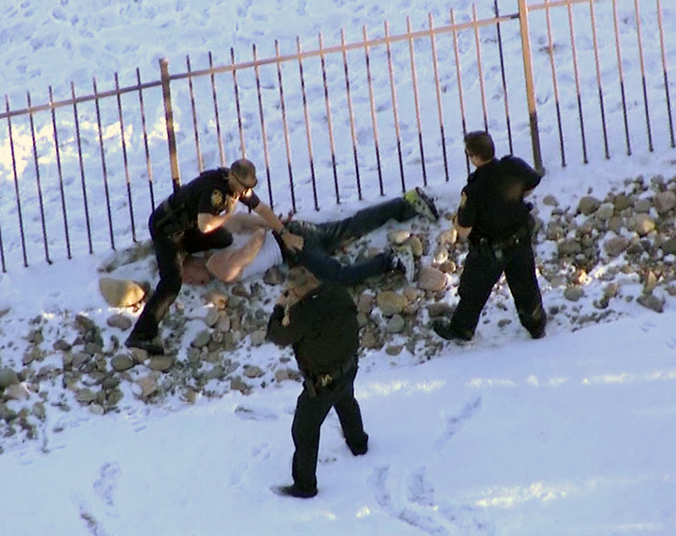 . In this image taken from video provided by CBS-4 TV Denver, Ryan Stone, 29, is apprehended by police in Lone Tree, Colo., on Wednesday, March 12, 2014. Stone, suspected of stealing an SUV with a 4-year-old boy inside, carjacking two other vehicles and seriously injuring a state trooper was arrested Wednesday after police tracked him, and at times chased him, around the Denver area during morning rush hour.  (AP Photo/CBS-4 TV Denver)