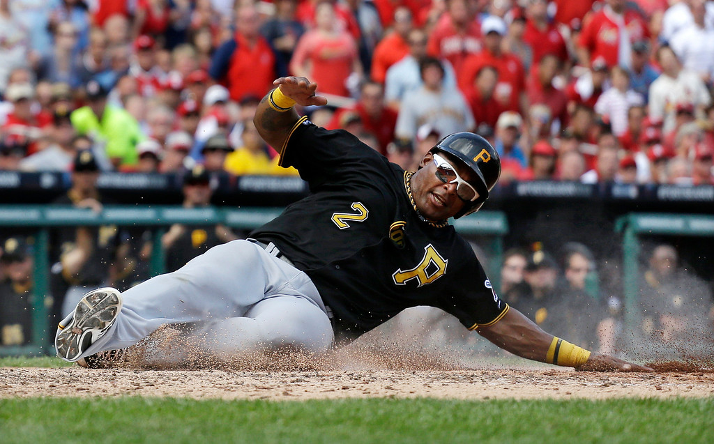 . Pittsburgh Pirates\' Marlon Byrd scores on a sacrifice fly by Russell Martin in the seventh inning of Game 2 in baseball\'s National League division series against the St. Louis Cardinals on Friday, Oct. 4, 2013, in St. Louis.  (AP Photo/Jeff Roberson)