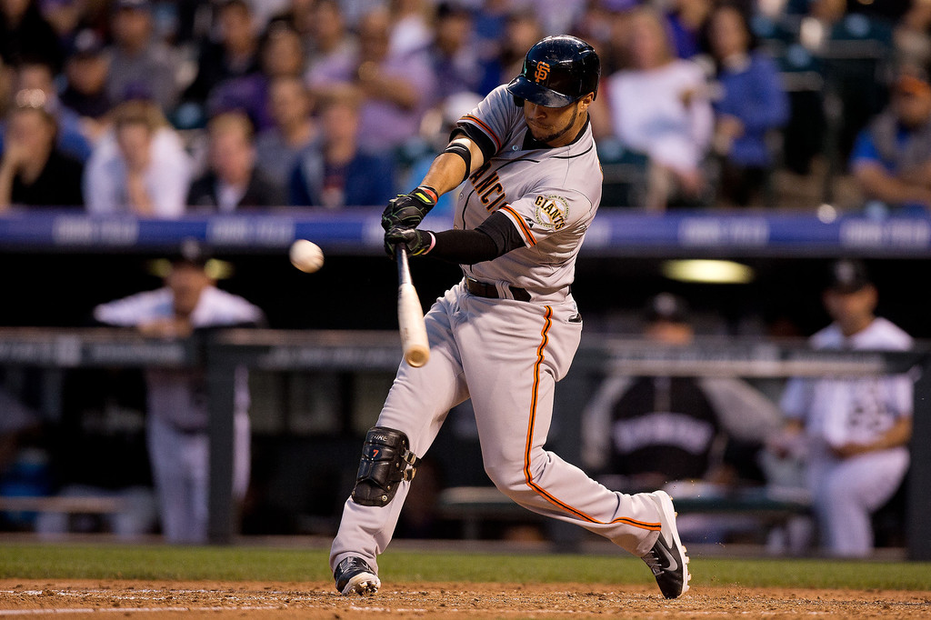. Gregor Blanco #7 of the San Francisco Giants hits a two RBI triple during the fifth inning against the Colorado Rockies at Coors Field on May 20, 2014 in Denver, Colorado. (Photo by Justin Edmonds/Getty Images)