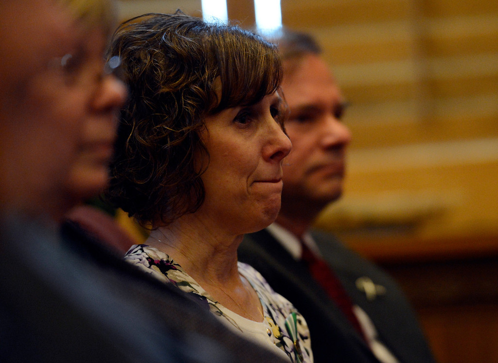 . DENVER, CO. - MARCH 20: Jane Dougherty, who\'s sister, Mary Sherlach, was killed at Sandy Hook, watches as Colorado Governor John Hickenlooper signing three gun control measures making stricter gun laws in Colorado, March, 20, 2013. (Photo By RJ Sangosti/The Denver Post)