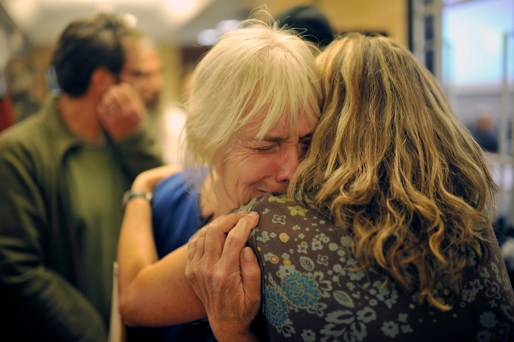 . BOULDER, CO - September 18 : Brooke Cholvin, right, comforts Jamestown evacuee Jan Reed at the Boulder County Commissioners building during a meeting for evacuated Jamestown residents in Boulder, Colorado. September 18, 2013. (Photo by Hyoung Chang/The Denver Post)