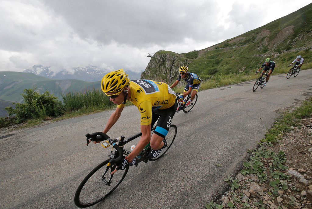 . Christopher Froome of Britain, wearing the overall leader\'s yellow jersey, Spain\'s Alberto Contador, Spain\'s Alejandro Valverde and Nairo Alexander Quintana of Colombia, wearing the best young rider\'s white jersey, from left to right, speed down Sarenne pass during the eighteenth stage of the Tour de France cycling race over 172.5 kilometers (107.8 miles) with start in Gap and finish in Alpe-d\'Huez, France, Thursday July 18, 2013. (AP Photo/Christophe Ena)