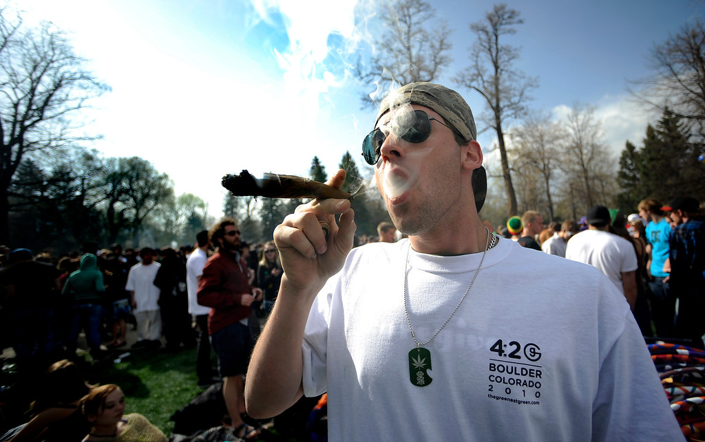 . Garrett Kramer smokes a large blunt during the 4/20 event on Norlin Quad at the University of Colorado in Boulder, Colorado April 20, 2010.  CAMERA/Mark Leffingwell