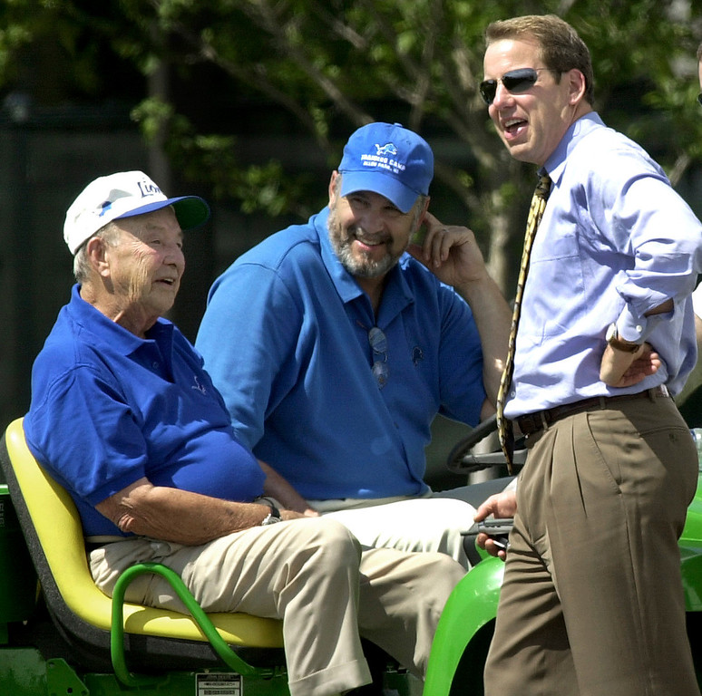 . In this July 28, 2003, file photo, William Clay Ford, left, Detroit Lions owner and chairman; Matt Millen, president and chief executive; and William Clay Ford Jr., right, vice chairman, talk during the NFL football team\'s practice in Allen Park, Mich. Bill Ford Jr. has seen enough of the way Millen is running his father\'s Detroit Lions. When asked Monday, Sept. 22, 2008, Ford said Millen should leave the team, but he didn\'t have the authority to make such a significant change. (AP Photo/Paul Sancya, File)