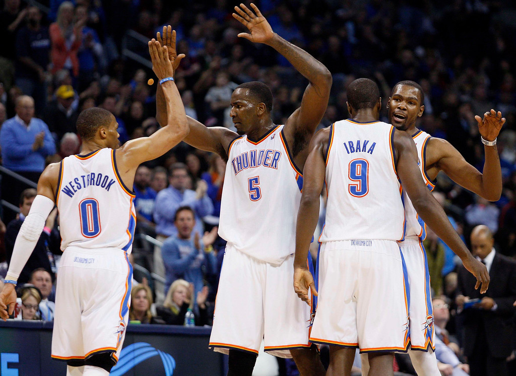 . Oklahoma City Thunder starters Russell Westbrook (L), Kendrick Perkins (5), Serge Ibaka (9), of Congo, and Kevin Durant (R) celebrate their play during a timeout against Denver Nuggets in the second half of their NBA basketball game in Oklahoma City, Oklahoma January 16, 2013. REUTERS/Bill Waugh