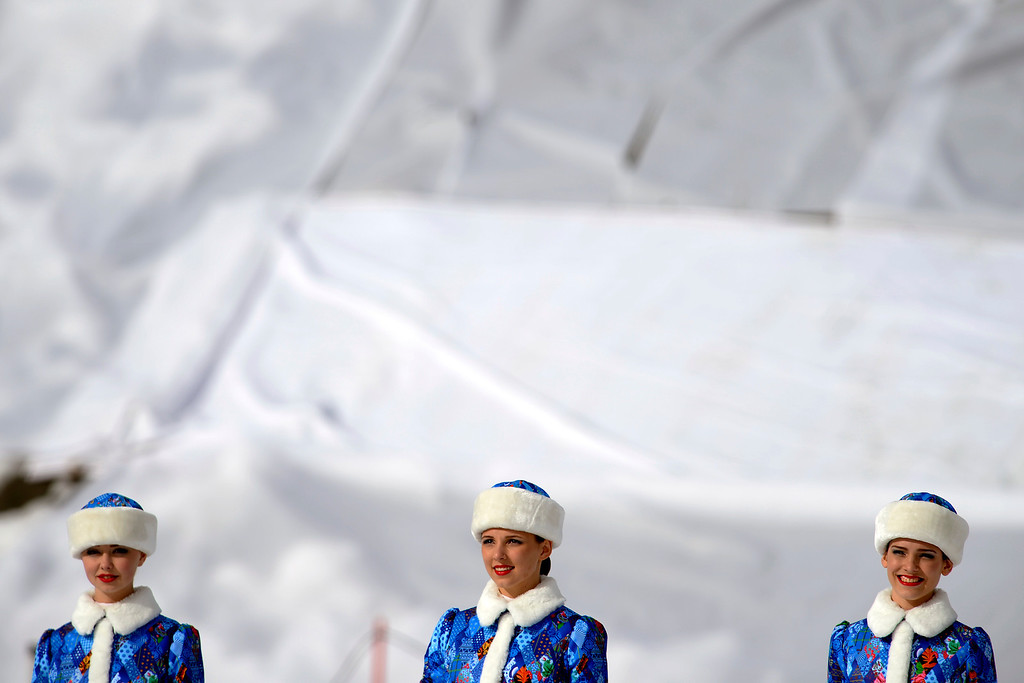 . ROSA KHUTOR, RUSSIA - FEBRUARY 09: Russian women stand at attention after having presented the winners with flowers after the women\'s snowboard slopestyle final. Sochi 2014 Winter Olympics at the Rosa Khutor Etreme Park on Sunday, February 9, 2014. (Photo by AAron Ontiveroz/The Denver Post)