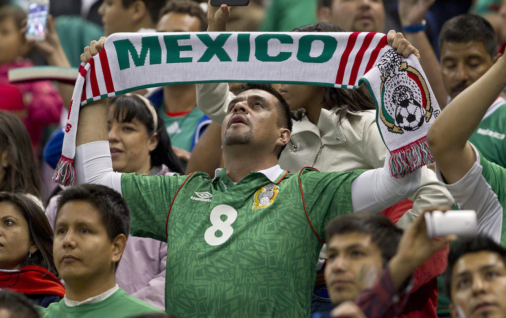 . Mexico\'s fans cheer during a World Cup 2014 qualifying match against the U.S. at the Aztec stadium in Mexico City, Tuesday, March 26, 2013. (AP Photo/Christian Palma)
