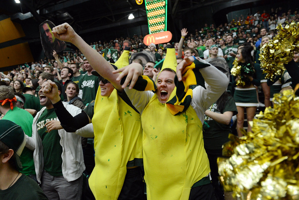 . Fort COLLINS, CO. - FEBRUARY 23: Dressed as bananas Colorado State students Max Weinhoeft and Davis Stassi  anticipate the start of the mens basketball game at Moby Arena in Fort Collin, CO February  24, 2013. The Colorado State Rams mens basketball team lost to the New Mexico Lobos, 82-91. (Photo By Craig F. Walker/The Denver Post)
