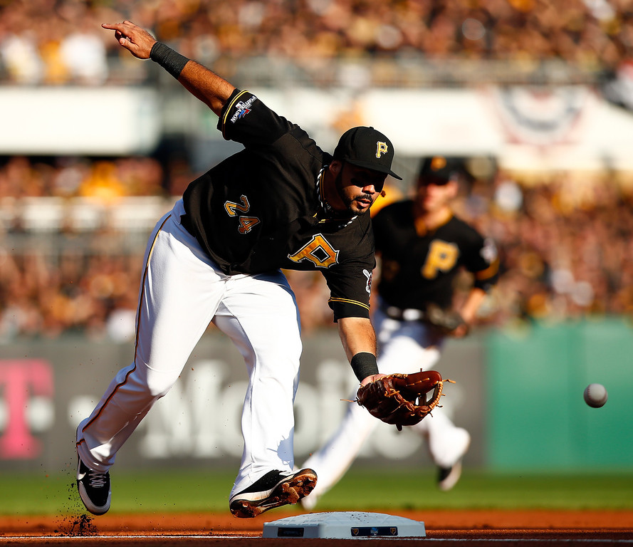 . Pedro Alvarez #24 of the Pittsburgh Pirates fields a ground ball in the first inning against the St. Louis Cardinals during Game Three of the National League Division Series at PNC Park on October 6, 2013 in Pittsburgh, Pennsylvania.  (Photo by Jared Wickerham/Getty Images)