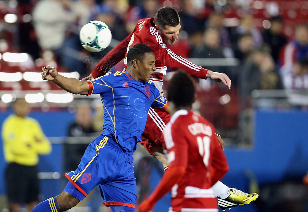 . FRISCO, TX - MARCH 02:  (L-R) Diego Calderon #5 of the Colorado Rapids jumps for a header against Kenny Cooper #33 of FC Dallas at FC Dallas Stadium on March 2, 2013 in Frisco, Texas.  (Photo by Ronald Martinez/Getty Images)