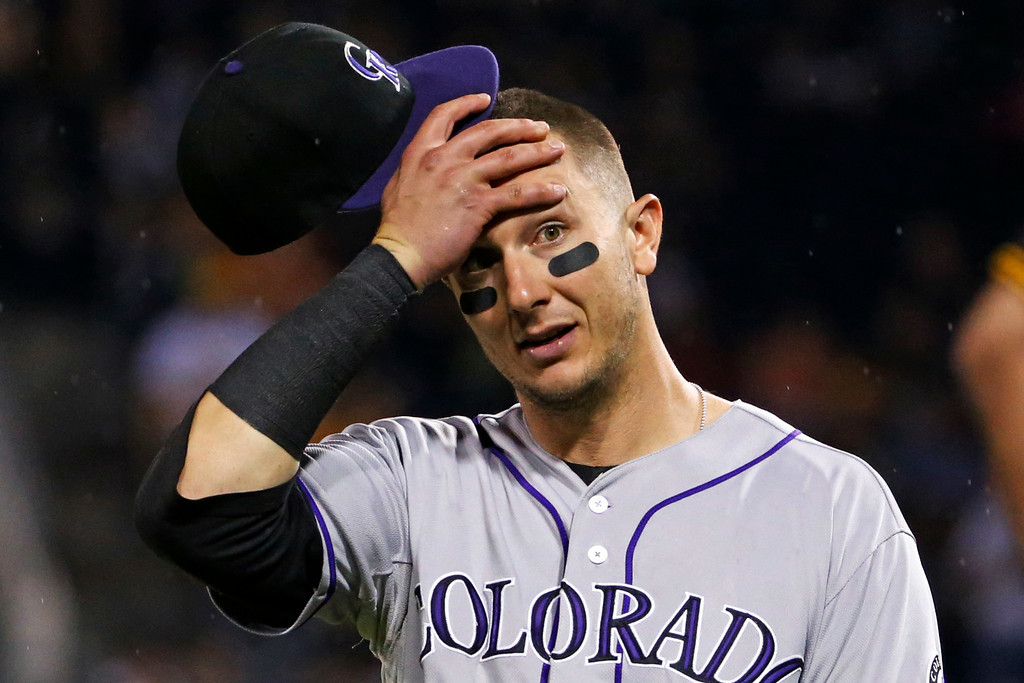 . Colorado Rockies shortstop Troy Tulowitzki reacts to Pittsburgh Pirates\' Starling Marte being hit in the head by a pitch from Rockies relief pitcher Adam Ottavino during the seventh inning of a baseball game in Pittsburgh on Friday, July 18, 2014. The Pirates won 4-2. (AP Photo/Gene J. Puskar)