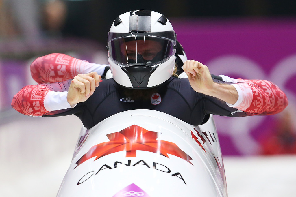 . Pilot Justin Kripps and Bryan Barnett of Canada team 3 make a run during the Men\'s Two-Man Bobsleigh heats on Day 9 of the Sochi 2014 Winter Olympics at Sliding Center Sanki on February 16, 2014 in Sochi, Russia.  (Photo by Alex Livesey/Getty Images)