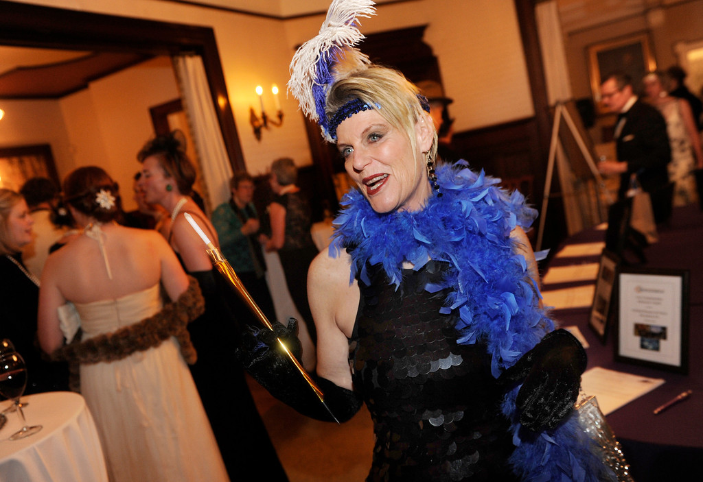 . Terri Johnson carried a faux cigarette holder. The Rocky Mountain PBS Masterpiece Costume Ball attracted more than 200 fans of the Downton Abbey television drama Saturday night, January 4, 2014 at the Grant Humphreys Mansion. The show\'s new season starts Sunday night. The event also included a silent auction, historical displays, and a costume contest. Photo By Karl Gehring/The Denver Post