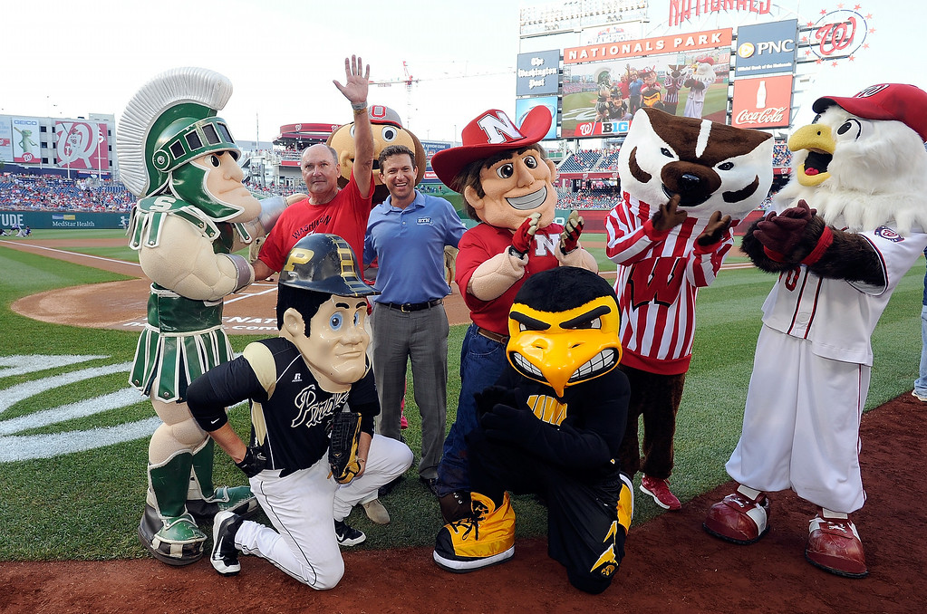 . WASHINGTON, DC - JUNE 30: Big Ten Commissioner Jim Delany and Big Ten Network president Mark Silverman pose with the Big Ten mascots and Natioanls mascot Screech before the game between the Washington Nationals and the Colorado Rockies at Nationals Park on June 30, 2014 in Washington, DC.  (Photo by Greg Fiume/Getty Images)
