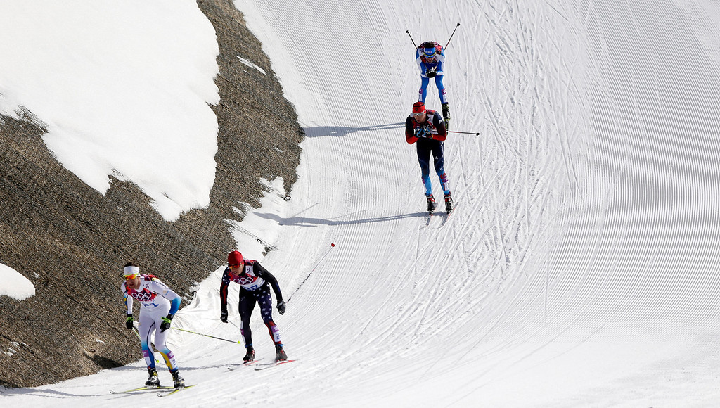 . Sweden\'s Anders Soedergren, United States\' Noah Hoffman, Russia\'s Alexander Legkov and Italy\'s Roland Clara, from left, compete during the men\'s 50K cross-country race at the 2014 Winter Olympics, Sunday, Feb. 23, 2014, in Krasnaya Polyana, Russia. (AP Photo/Matthias Schrader)