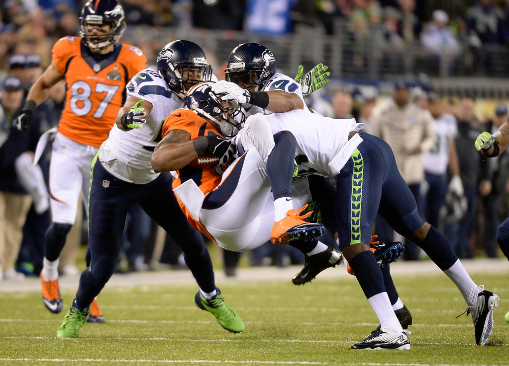. Denver Broncos wide receiver Demaryius Thomas (88) crushed after catching a pass during the second quarter. The Denver Broncos vs the Seattle Seahawks in Super Bowl XLVIII at MetLife Stadium in East Rutherford, New Jersey Sunday, February 2, 2014. (Photo by John Leyba/The Denver Post)