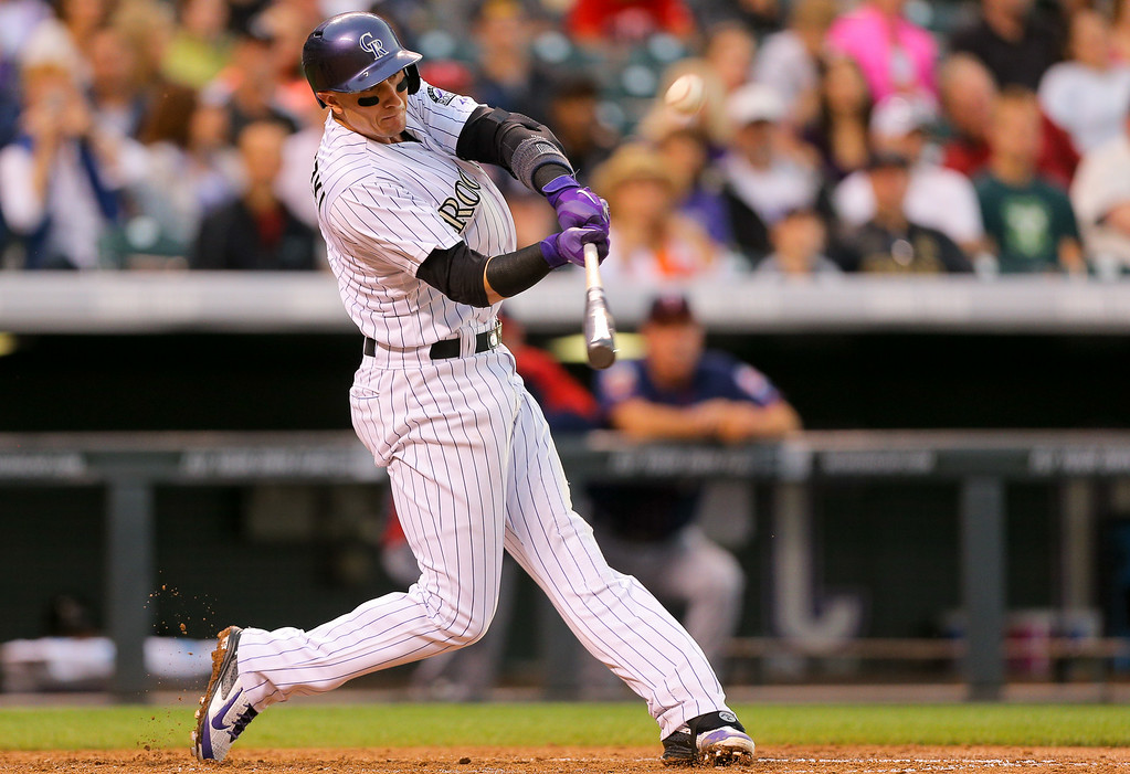 . DENVER, CO - JULY 11: Troy Tulowitzki #2 of the Colorado Rockies hits a two run home run during the third inning against the Minnesota Twins at Coors Field on July 11, 2014 in Denver, Colorado. (Photo by Justin Edmonds/Getty Images)