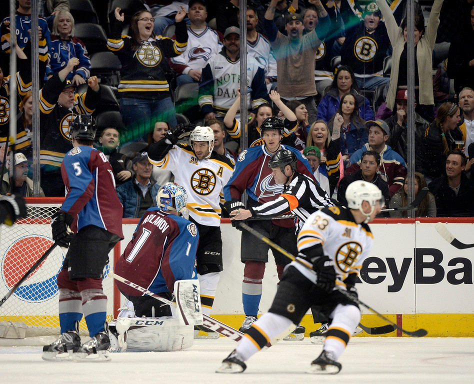 . Boston center Patrice Bergeron (37) celebrated his goal in the first period. The Colorado Avalanche hosted the Boston Bruins at the Pepsi Center Friday night, March 21, 2014. (Photo by Karl Gehring/The Denver Post)