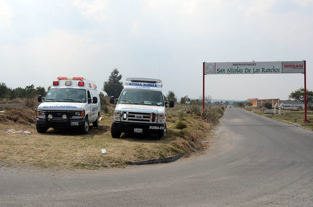 . Two ambulances remain parked at the entrance to San Nicolas de los Ranchos community near Popocatepetl volcano, in Puebla, Mexico, on May 12, 2013. According to a report by the National Center of Prevention of Disasters (CENAPRED) the yellow alert phase three is still in force.    Jose Castañares/AFP/Getty Images
