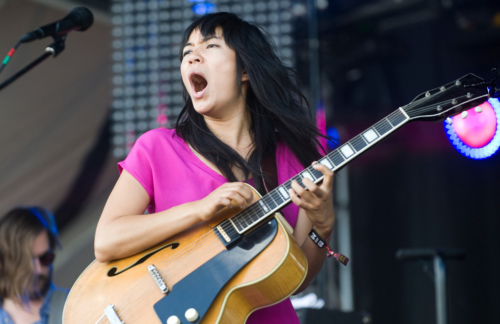 . Thao Nguyen of Thao & The Get Down Stay Down performs on the first day of the Austin City Limits festival in Austin, Texas, on Friday Oct. 4, 2013. (AP Photo/Austin American-Statesman, Erika Rich)