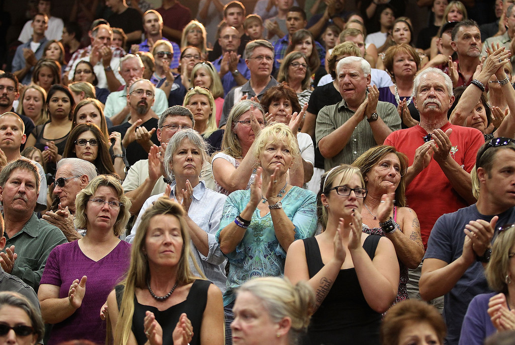 . The community gives a standing ovation as local firefighters arrive to the memorial service at EmbryRiddle Aeronautical University on July 1, 2013 in Prescott, Arizona.  (Photo by Christian Petersen/Getty Images)