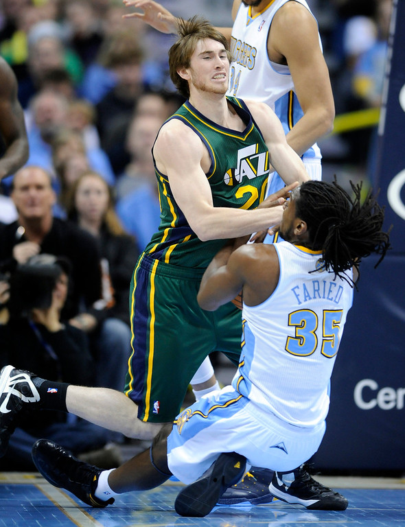 . Utah Jazz guard Gordon Hayward (20) and Denver Nuggets forward Kenneth Faried (35) fight for a loose ball during the first quarter of an NBA basketball game on Saturday, Jan. 5, 2013, in Denver (AP Photo/Jack Dempsey)