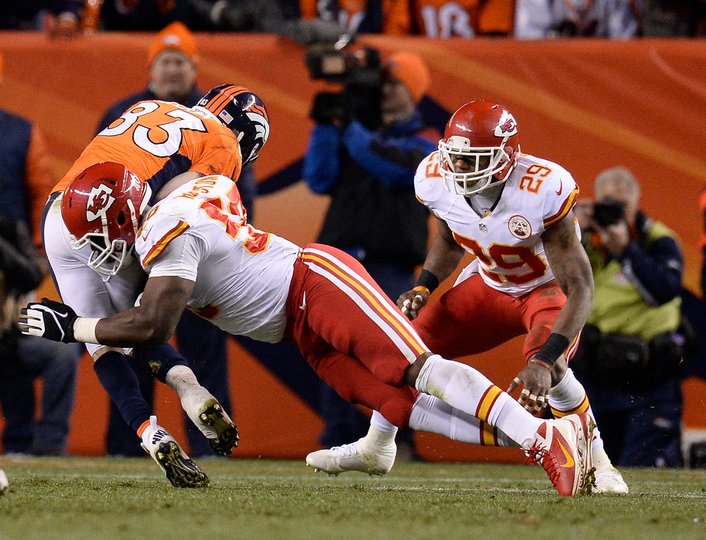 . Kansas City Chiefs outside linebacker Justin Houston (50) tackles Denver Broncos wide receiver Wes Welker (83) in the second quarter. The Denver Broncos take on the Kansas City Chiefs at Sports Authority Field at Mile High in Denver on November 17, 2013. (Photo by John Leyba/The Denver Post)