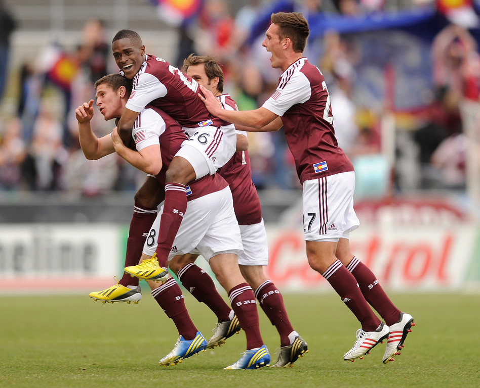 . Deshorn Brown (26) jumped on the back of Rapids\' midfielder Dillon Powers following his first half goal. The Colorado Rapids hosted the Portland Timbers Saturday, March 30, 2013 at Dick\'s Sporting Goods Park in Commerce City.  Photo By Karl Gehring/The Denver Post)