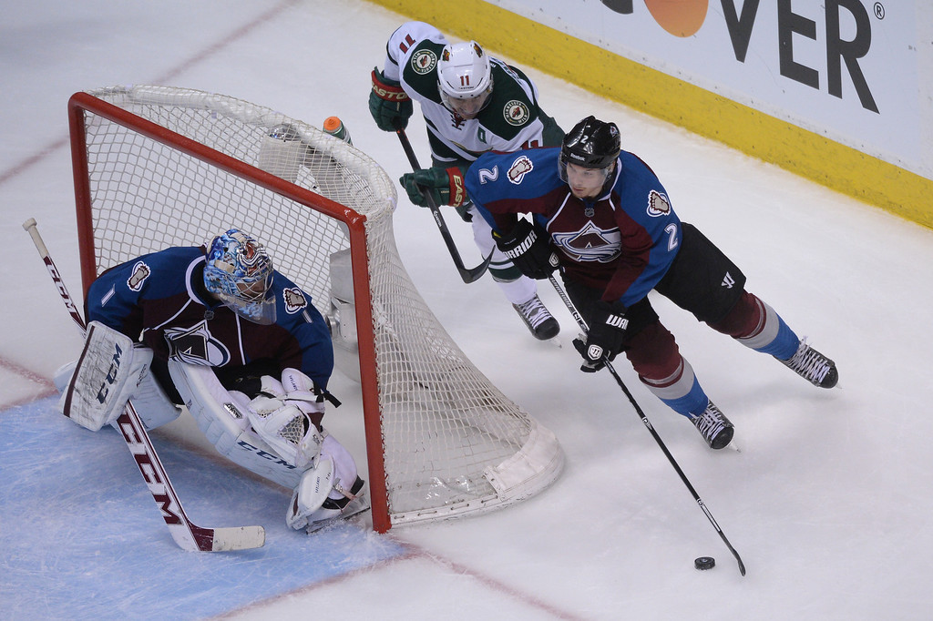 . Nick Holden (2) of the Colorado Avalanche moves with the puck around Semyon Varlamov (1) of the Colorado Avalanche chased by Zach Parise (11) of the Minnesota Wild during the third period of action.   (Photo by Karl Gehring/The Denver Post)